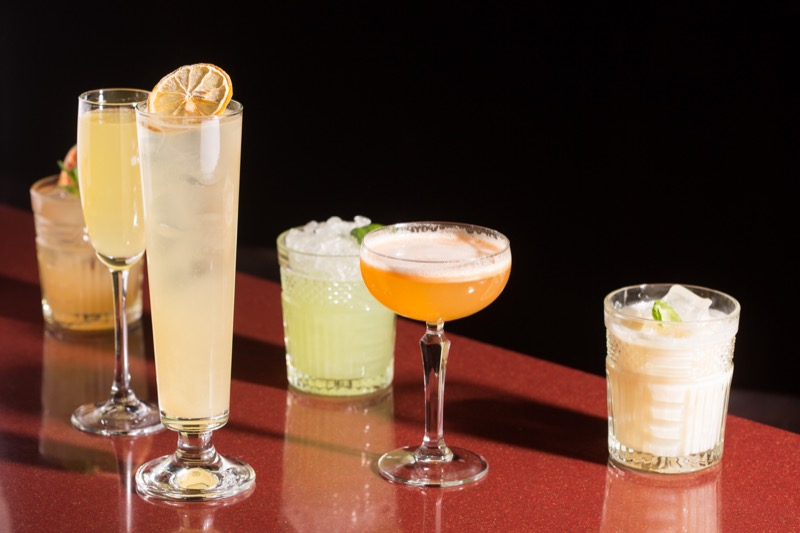various cocktails. alcoholic drinks on a dark background